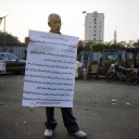 Tahrir Square man written sign 039